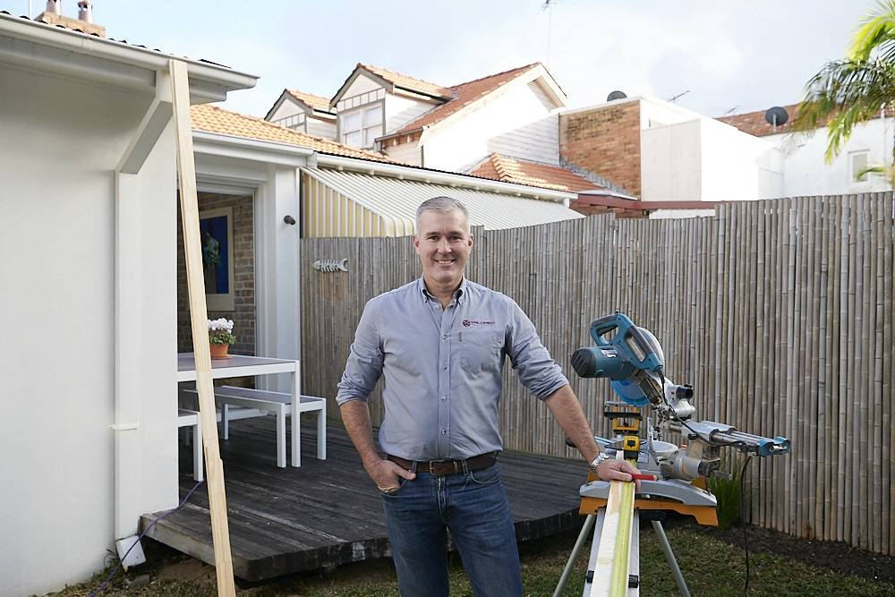 ON THE JOB: Builder and owner of Tailored Construction Group Jonathan Hayes said government measures do not stop a tradie from doing their job.